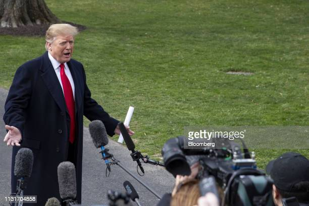 US President Donald Trump speaks to members of the media on the South Lawn of the White House before boarding Marine One in Washington DC US on...