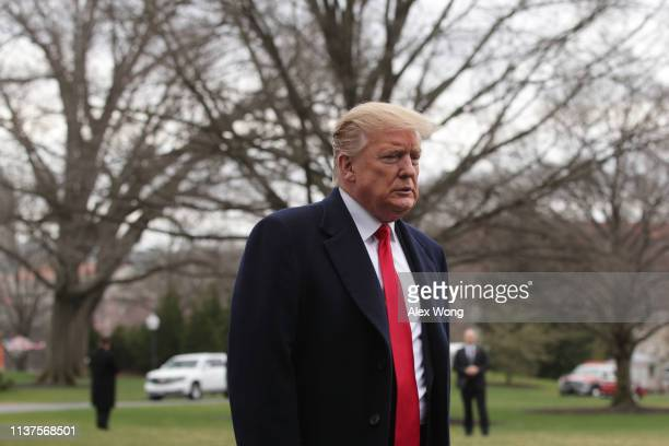 S President Donald Trump speaks to members of the media on the South Lawn prior to his departure from the White House March 22 2019 in Washington DC...
