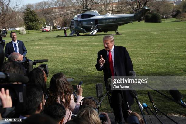 President Donald Trump speaks to members of the media on the South Lawn prior to his departure from the White House March 28, 2019 in Washington, DC....