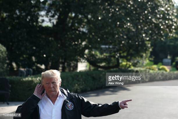 S President Donald Trump speaks to members of the media prior to a Marine One departure at the South Lawn of the White House September 19 2018 in...