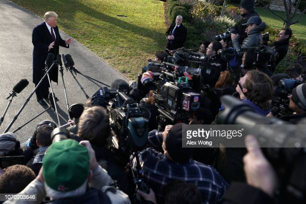 S President Donald Trump speaks to members of the media prior to his departure from the White House November 20 2018 in Washington DC President Trump...