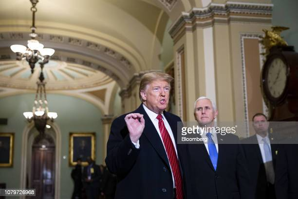 US President Donald Trump speaks to members of the media while arriving to a Senate Republicans policy luncheon with US Vice President Mike Pence...