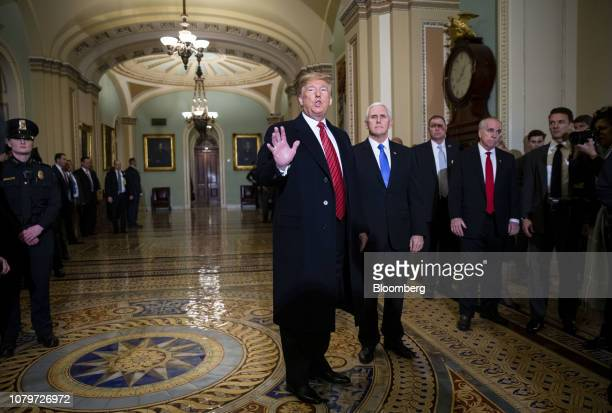 US President Donald Trump speaks to members of the media while arriving to a Senate Republicans policy luncheon with US Vice President Mike Pence at...