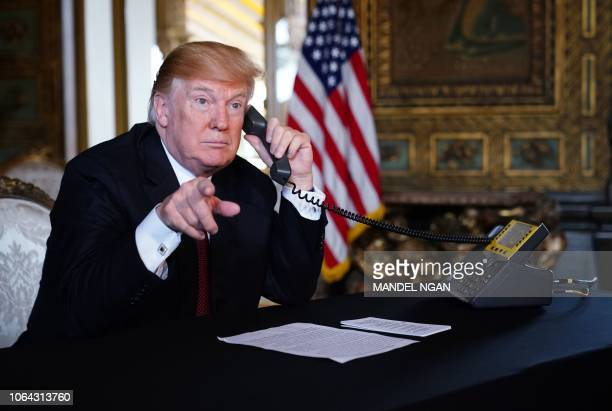 President Donald Trump speaks to members of the military via teleconference from his MaraLago resort in Palm Beach Florida on Thanksgiving Day...