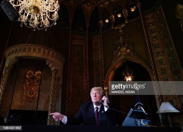 US President Donald Trump speaks to members of the military via teleconference from his MaraLago resort in Palm Beach Florida on Thanksgiving Day...