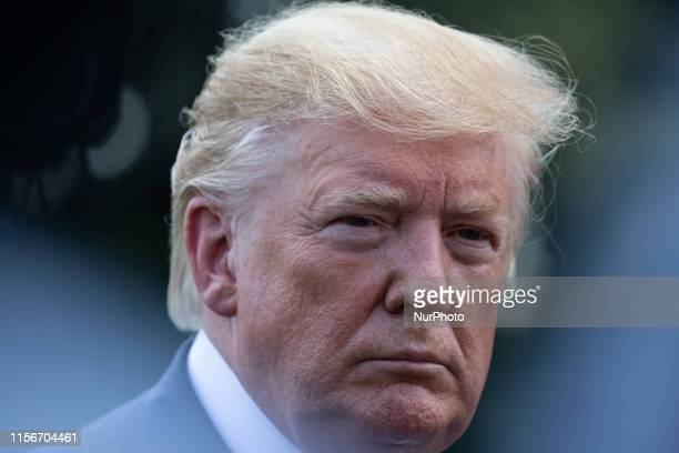 US President Donald Trump speaks to members of the press prior to his departure from the South Lawn of the White House in Washington DC on Friday...