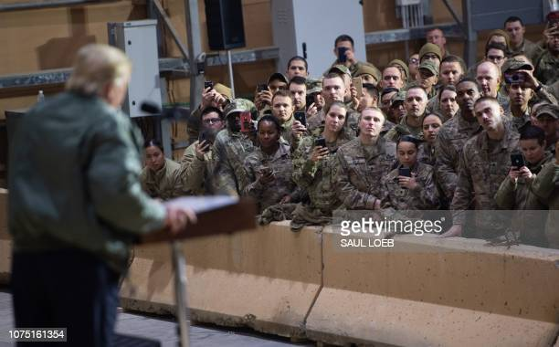 US President Donald Trump speaks to members of the US military during an unannounced trip to Al Asad Air Base in Iraq December 26 2018 President...