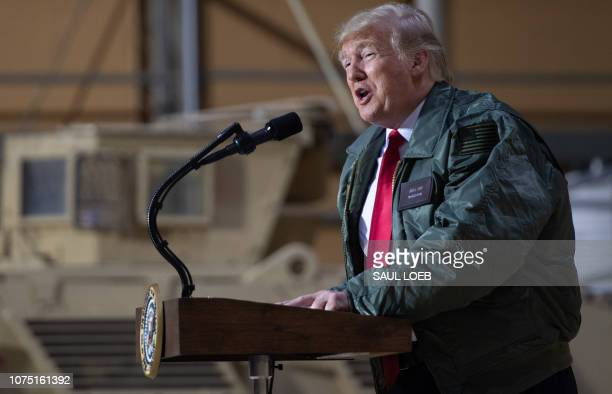 US President Donald Trump speaks to members of the US military during an unannounced trip to Al Asad Air Base in Iraq on December 26 2018 President...