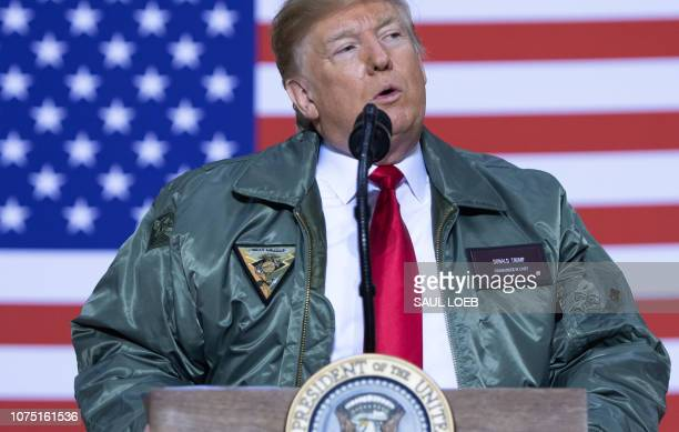 President Donald Trump speaks to members of the US military during an unannounced trip to Al Asad Air Base in Iraq December 26 2018 President Donald...