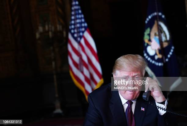 US President Donald Trump speaks to military members via teleconference from his MaraLago resort in Palm Beach Florida on November 22 2018