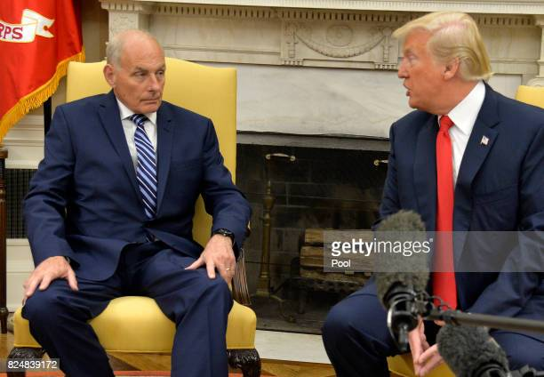 President Donald Trump speaks to new White House Chief of Staff John Kelly after he was sworn in in the Oval Office of the White House July 31 2017...