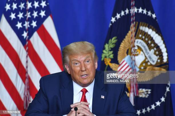 President Donald Trump speaks to officials during a roundtable discussion on community safety, at Mary D. Bradford High School in in Kenosha,...