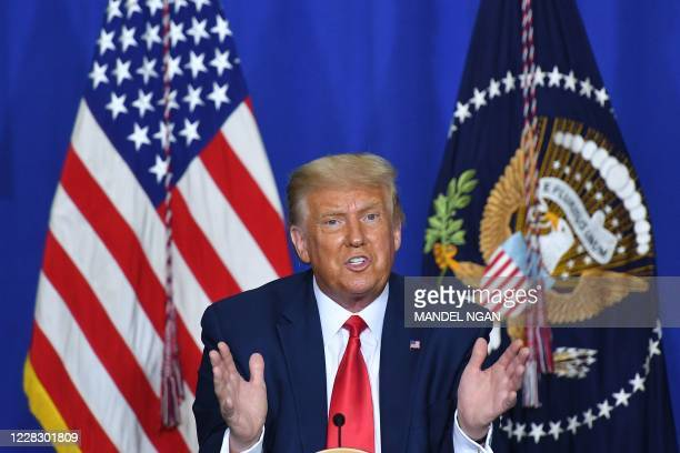US President Donald Trump speaks to officials during a roundtable discussion on community safety at Mary D Bradford High School in in Kenosha...