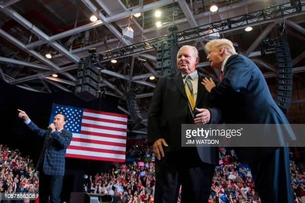US President Donald Trump speaks to radio talk show host Rush Limbaugh while Lee Greenwood performs God Bless The USA at a Make America Great Again...