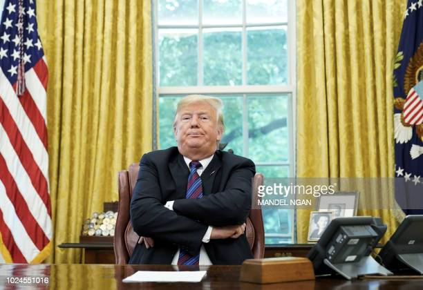 US President Donald Trump speaks to reporters after a phone conversation with Mexico's President Enrique Pena Nieto on trade in the Oval Office of...