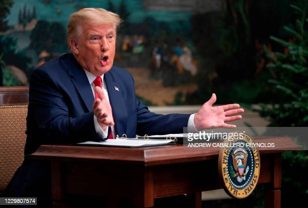 President Donald Trump speaks to reporters after participating in a Thanksgiving teleconference with members of the United States Military, at the...