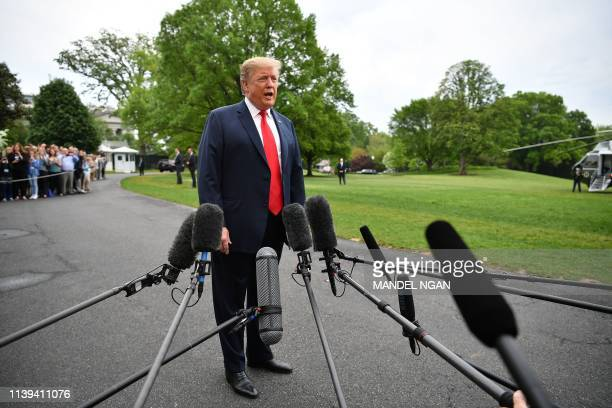 US President Donald Trump speaks to reporters before boarding Marine One from the South Lawn of the White House in Washington DC on April 26 2019...