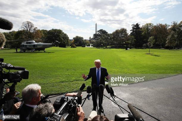 President Donald Trump speaks to reporters before boarding Marine One to depart from the White House on October 25 2017 in Washington DC President...