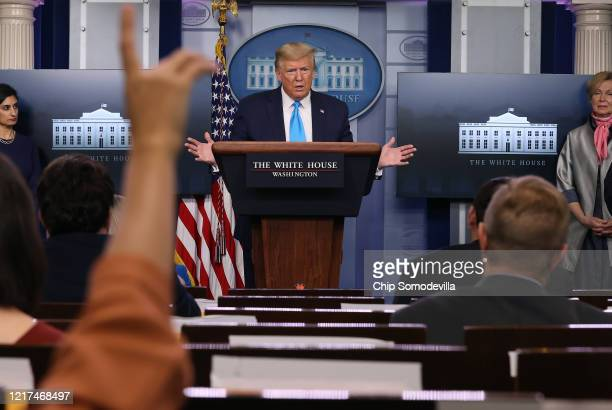 President Donald Trump speaks to reporters following a meeting of the coronavirus task force in the Brady Press Briefing Room at the White House on...