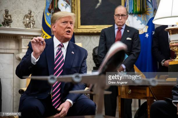 S President Donald Trump speaks to reporters in the Oval Office of the White House as he meets with US Representative Jeff Van Drew of New Jersey who...