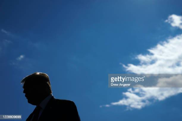 President Donald Trump speaks to reporters on his way to Marine One on the South Lawn of the White House on September 30, 2020 in Washington, DC....