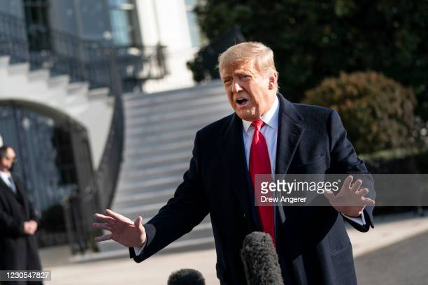President Donald Trump speaks to reporters on the South Lawn of the White House before boarding Marine One on January 12, 2021 in Washington, DC....