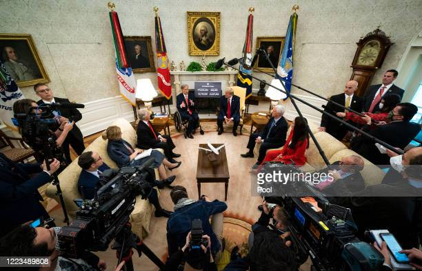 President Donald Trump speaks to reporters while hosting Texas Governor Greg Abbott about what his state has done to restart business during the...