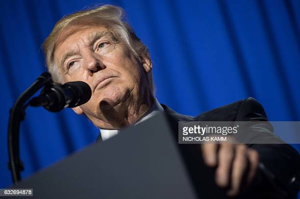 US President Donald Trump speaks to staff at the Department of Homeland Security in Washington DC on January 25 2017 Trump vowed to restore 'control'...