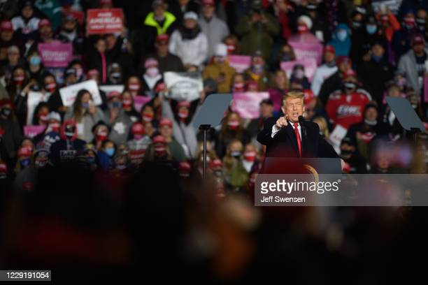 President Donald Trump speaks to supporters at a campaign rally at North Coast Air aeronautical services at Erie International Airport on October 20,...