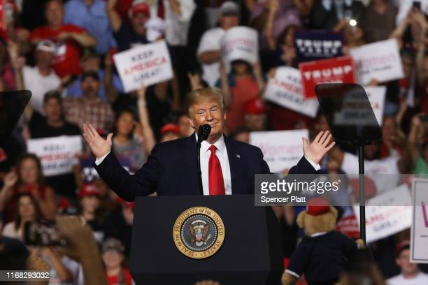 President Donald Trump speaks to supporters at a rally in Manchester on August 15, 2019 in Manchester, New Hampshire. The Trump 2020 campaign is...