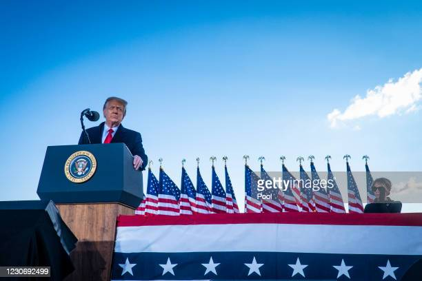 President Donald Trump speaks to supporters at Joint Base Andrews before boarding Air Force One for his last time as President on January 20, 2021 in...