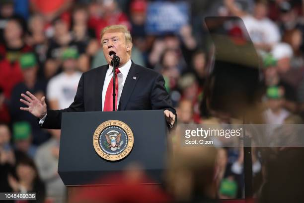 S President Donald Trump speaks to supporters during a campaign rally at the MidAmerica Center on October 9 2018 in Council Bluffs Iowa The rally is...