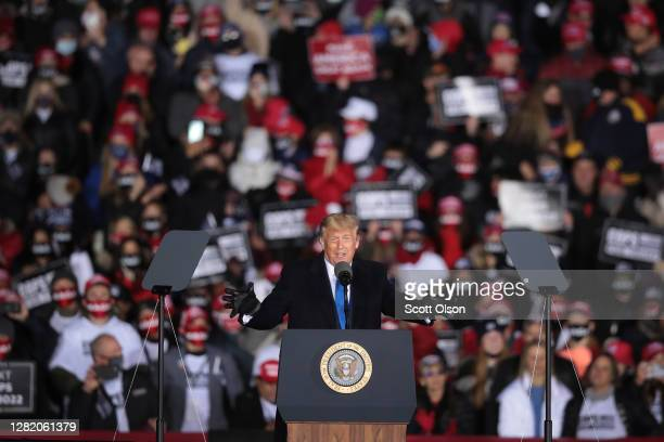 President Donald Trump speaks to supporters during a campaign rally at the Waukesha County Airport on October 24, 2020 in Waukesha, Wisconsin. Trump...