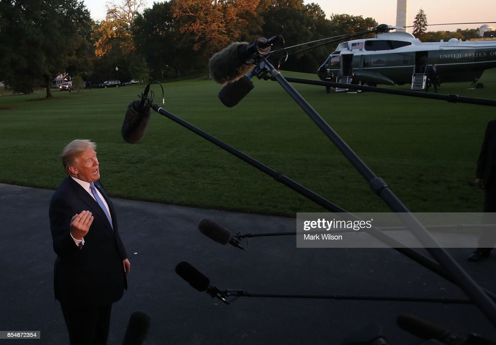 US President Donald Trump speaks to the media after arriving back at the White House on Marine One September 27, 2017 in Washington, DC. President Trump traveled to Indianapolis, Indiana to unveil his administration's tax reform plan.