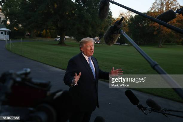 President Donald Trump speaks to the media after arriving back at the White House on Marine One September 27 2017 in Washington DC President Trump...