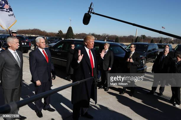 S President Donald Trump speaks to the media after arriving for a meeting at the Pentagon on January 18 2018 in Arlington Virginia Also pictured are...