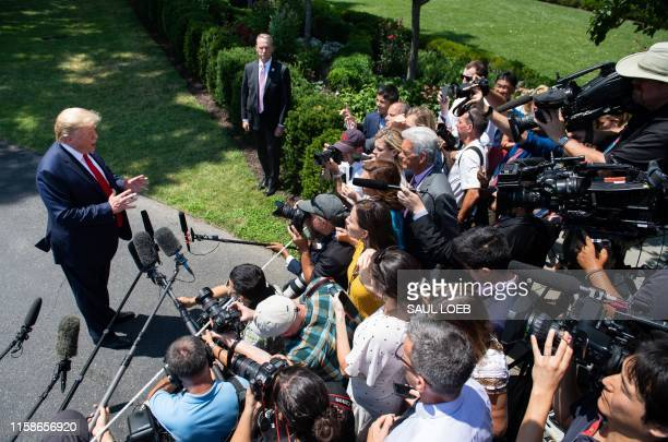 President Donald Trump speaks to the media after arriving on the South Lawn of the White House in Washington, DC, July 30 following a trip to the...