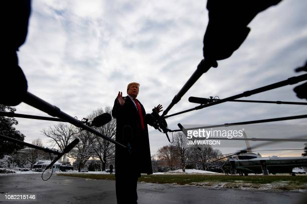 US President Donald Trump speaks to the media as he departs the White House in Washington DC on January 14 2019 en route to New Orleans Louisiana to...