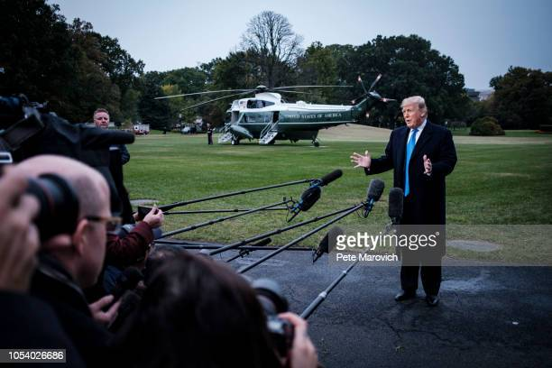 President Donald Trump speaks to the media as he prepares to board Marine One on the South Lawn of the White House on October 26, 2018 in Washington,...