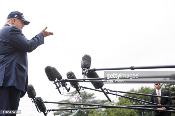 President Donald Trump speaks to the media as he walks from Marine One to the White House following a weekend at Camp David, on September 1, 2019 at...