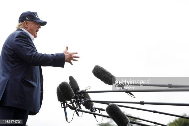 S President Donald Trump speaks to the media as he walks from Marine One to the White House following a weekend at Camp David on September 1 2019 at...