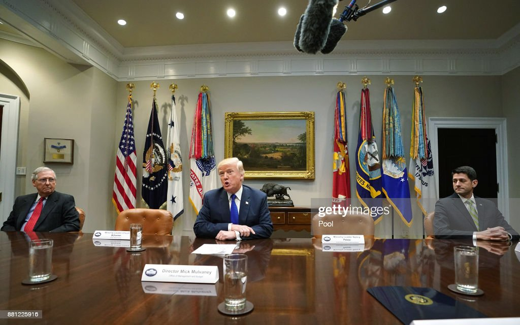 U.S. President Donald Trump speaks to the media as Senate Majority Leader Mitch McConnell (L), R-KY, and Speaker of the House Paul Ryan, R-WI, look on during a meeting with congressional leadership in the Roosevelt Room at the White House on November 28, 2017 in Washington, DC. Trump spoke on the recent intercontinental ballistic missile launch by North Korea. Democratic leaders Sen. Charles Schumer, D-NY, and Rep. Nancy Pelosi, D-CA, skipped the meeting with President Trump.