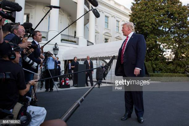 President Donald Trump speaks to the media before boarding Marine One on the South Lawn of the White House on October 7 2017 in Washington DC...