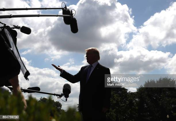 President Donald Trump speaks to the media before departing from the White House on September 27 2017 in Washington DC President Trump is traveling...