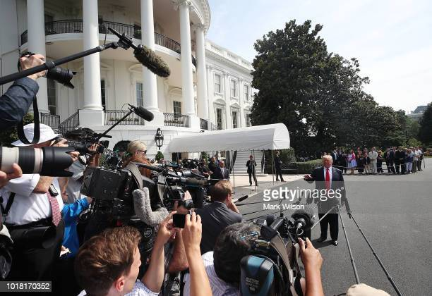 S President Donald Trump speaks to the media before departing on Marine One to travel to New York at the White House on August 17 2018 in Washington...