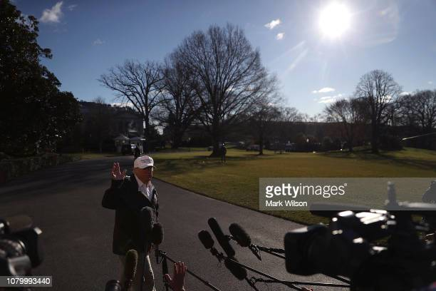 S President Donald Trump speaks to the media before departing on Marine One from the White House on January 10 2019 in Washington DC President Trump...