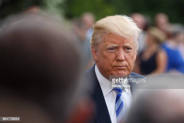 President Donald Trump speaks to the media before leaving the White House for a day trip to Dallas Texas