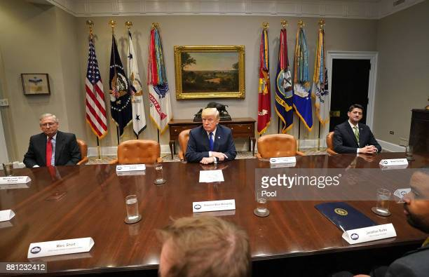 President Donald Trump speaks to the media during a meeting with congressional leadership in the Roosevelt Room at the White House on November 28...