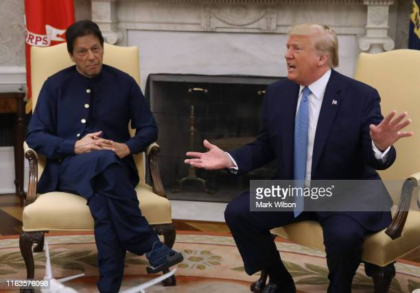 President Donald Trump speaks to the media during a meeting with Prime Minister of the Islamic Republic of Pakistan, Imran Khan in the Oval Office at...