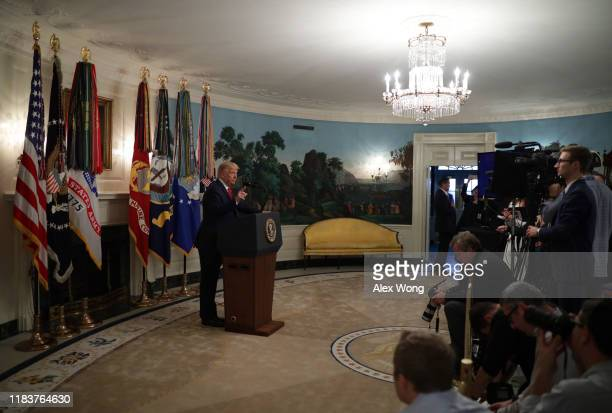 President Donald Trump speaks to the media in the Diplomatic Reception Room of the White House October 27, 2019 in Washington, DC. President Trump...